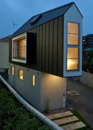 A Kitchen In Black And White Panda S House by This Narrow House In Japan Only Looks Tiny Until You Look Inside