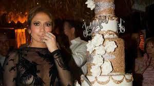 jennifer lopez celebrates 48th birthday with gold cake u2013 daily
