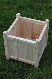 small wooden garden planter or plant pot cover for indoor or