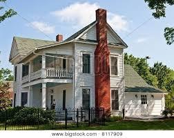 two story farmhouse white two story farmhouse with brick chimney chimney