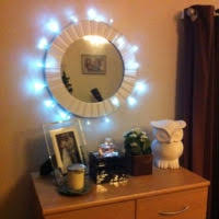 furniture rectangle mirror with small lights around it and carved