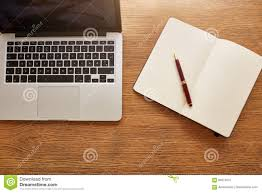 laptop with diary and pen on work desk stock photo image 69510331