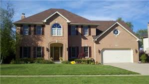 i like teh brown shutters against the pink brick our house is a
