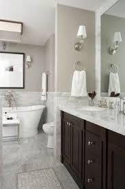 Bathroom Vanity Backsplash Ideas by This Gray Contemporary Bathroom Features A Double Vanity Design