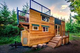 basecamp tiny home boasts a large rooftop deck for mountain