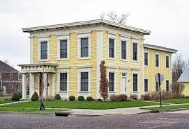 italianate style house yellow italianate square house stock image image of bracket