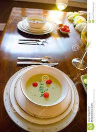 Beautiful Place Settings Elegant Dinner Setting With White Wine And Soup Stock Photo