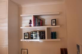 decor floating bookshelves fitted between the wall with photo