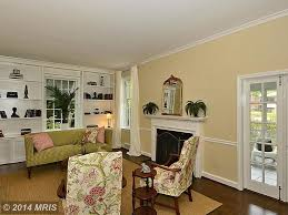 tropical living room with crown molding u0026 cement fireplace in