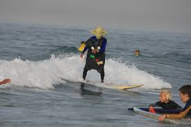 surfer halloween costume photos californians paddle out for halloween surf contests