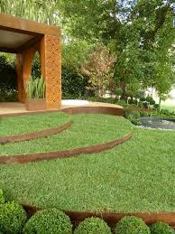 sinuous curves of cor ten steel edged lawn sweep across paal