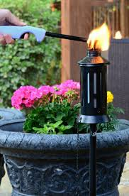 Patio Torch Lights by Natural Vibrant Dancing Flame From Tiki Torches As Your Ambient