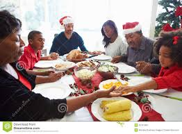 thanksgiving prayer for christmas multi generation family praying before christmas meal royalty free