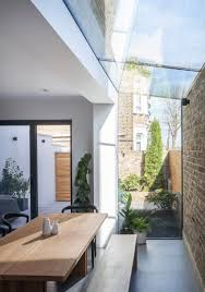 mulroy architects extends house with angled skylights and glass