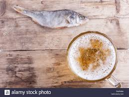 Wooden Table Top View Beer And One Fish On Wood Table Top View Background Stock Photo