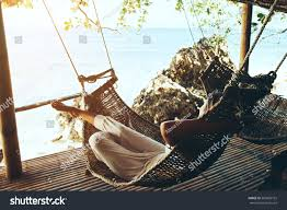 woman relaxing hammock on tropical beach stock photo 565859752