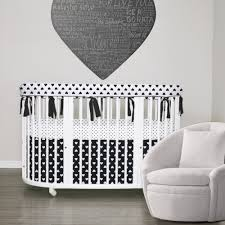 stokke crib bedding shown in stokke sleepi with our 3pc rail guard