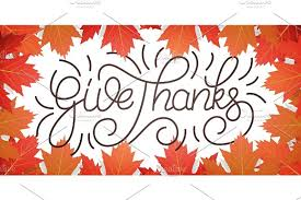 thanksgiving day give thanks lettering and falling autumn leaves