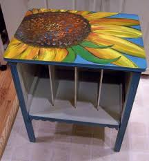 painting a coffee table with cool sunflower oil painting on top