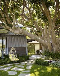 exterior design hanging outdoor chair and flagstone walkway in