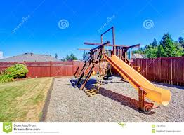 fenced backyard with playground for kids stock photo image 43515025