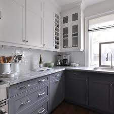 white upper cabinets dark lower cabinets contemporary kitchen