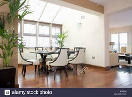 modern loft furniture traditional table and cream chairs in modern loft conversion