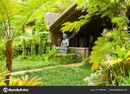hawaiian house with statue in the jungle kawaii hawaii united