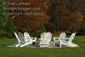stock photography of a circle of white adirondack chairs