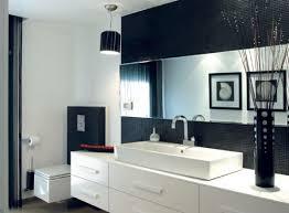 bathroom corner pedestal sink in black and white bathroom design
