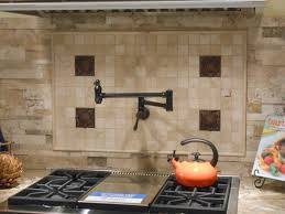 herringbone tile with accent feature over stove backsplash