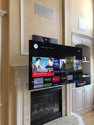 tv above fireplace fireplace tv pull down dynamic mounting