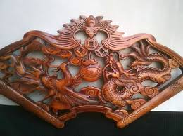 carved statues chor wood plate