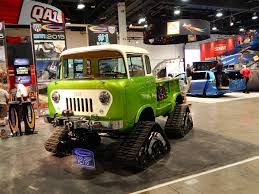 acid yellow jeep jeep fc 170 pickup has tracks hemi v8 and acid green paint