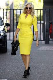 yellow dress carol vorderman shows sensational figure in fitted yellow
