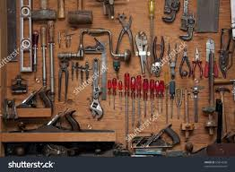 assortment of diy do it yourself tools hanging in a wooden