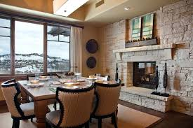 dining table in front of fireplace dining room dining room fireplace stone with ceiling beams and