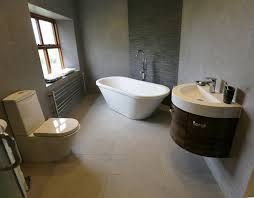 sink bathroom stand alone bath slate tile feature behind tub