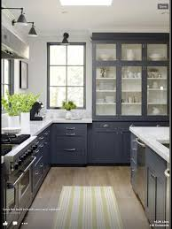 dark grey kitchen cabinets white walls black window love