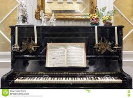 antique piano with candles and musical score indoor decoration