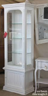 curio cabinet curioabinet with wicker rug and brick walls also