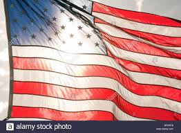 The Amarican Flag The American Flag Backlit By The Sun Stock Photo Royalty Free