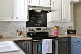 white cabinets gray countertops green carving stained wooden frame