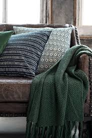 throw blankets for sofa natural fibers and neutral colors add a countryside feel to