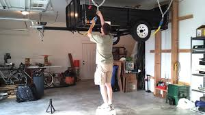 custom overhead garage storage lift for large garage with exposed