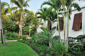 window shutters landscape tropical with flower bed white house