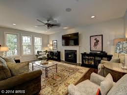 Ceiling Fan In Living Room by Traditional Living Room With Cement Fireplace U0026 Metal Fireplace In