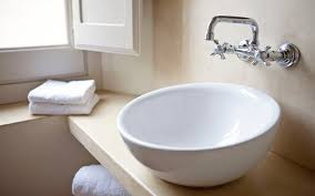 How To Install A Bathroom Sink And Vanity by Mounting A Vessel Sink Above The Countertop