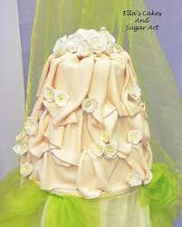 wedding cake decorated with buttercream icing and sugarpaste roses