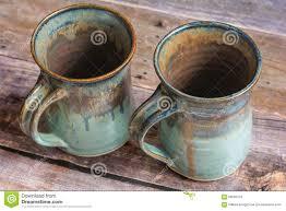 rustic coffee mugs two rustic clay mugs on a old barn board floor stock photo image